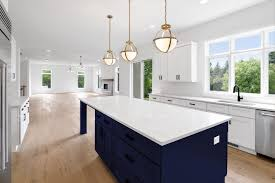 blue kitchen island and white cabinets navy is the new black all the perks of navy cabinets