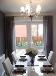 wall to wall curtains surrounding french doors for the dining