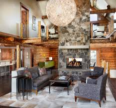 rustic log retreat blends modern accents and spectacular views colorado log cabin great room fireplace