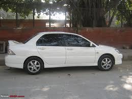 white mitsubishi lancer with black rims it u0027s white it u0027s sports and it u0027s a mitsubishi cedia 1 4 lakh km