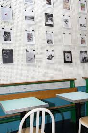 best 20 cafe wall ideas on pinterest cafe shop design coffee pegboard wall treatment in lieu of corkboard for office