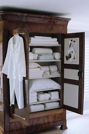 armoire linen cupboard 12 armoires as linen closets the organized home
