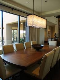 square shaped crystal chandelier design with elegant wooden dining