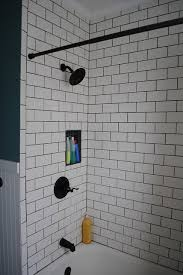 grouting bathtub tile subway tile bathroom dark grout and fixtures does this look work
