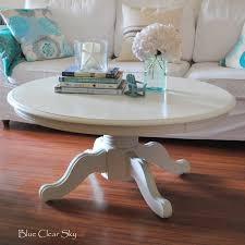 rustic maple painted white pedestal coffee table with hydrangeas