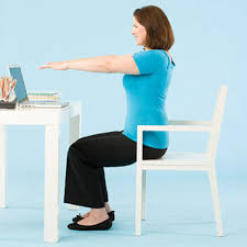 Desk Exercises At Work Get Rid Of Job Related Jiggle Work Out At Work Fitness Magazine