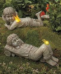 child with ducks and solar watering can garden yard statue