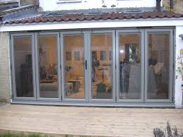 bi fold patio glass door with varnished wooden frame combined