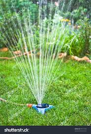 water sprinkler irrigation system technique watering stock photo