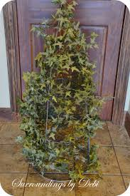 create a tomato cage topiary surroundings by debi