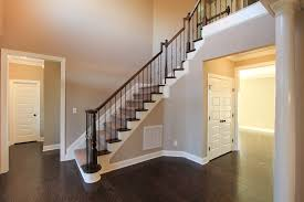 greige walls with wooden banisters richer brown than ours