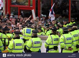 Blackburn Flags Large Crowds Flags And Banners At The English Defence League Stock