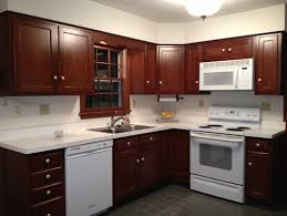 white cabinets with white appliances brown cabinets white corian countertop w white appliances