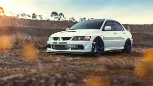 mitsubishi white mitsubishi lancer evolution 9 white car wallpaper 1600x900