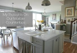 carrara marble kitchen island my thoughts on our marble countertops jeanne oliver