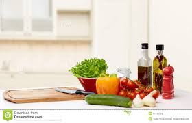 vegetables spices and kitchenware on table stock photo image