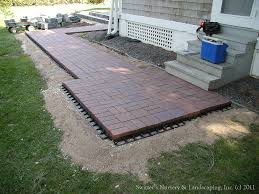 Paver Patio Installation by Clay Paver Dinning Patio With Natural Stone Raised Planter And