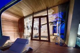 wooden deck terrace floor to ceiling windows iniala beach house