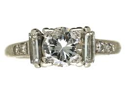art deco platinum solitaire diamond ring with baguette diamonds