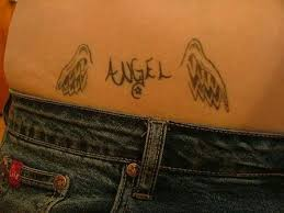 grey ink small wings on lowerback tattooshunt com
