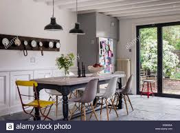 table in the kitchen eames dsw chairs around farmhouse table in kitchen with limestone
