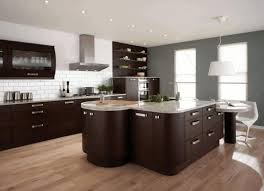 Modern Kitchen With White Appliances Black Cabinets Kitchen White Polished Wood Countertop Table White
