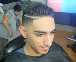 tag fade haircut with part designs latest men haircut