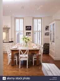 Modern Kitchen Dining Room Design White Chairs At Simple Wood Table In Modern Kitchen Dining Room
