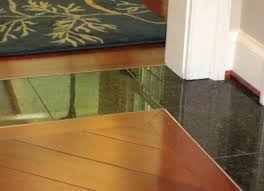 glass tile transition between floors instead of wood or