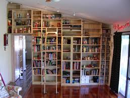 billy bookcase library wall with home made rolling ladder i