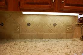 travertine backsplash with custom inlay fun with tile