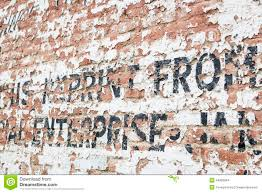 old weathered brick wall with advertisement stock photo image