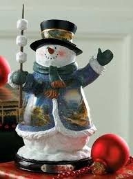 terry redlin s winter snowman now joined by new