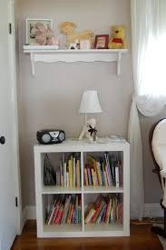 white bookshelf for nursery orange fur rug the third shelf
