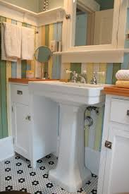 love the pedestal sink with the cabinets counters on each side