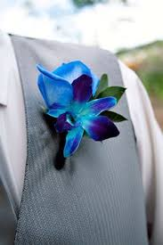 blue boutonniere calla with blue dendrobium orchid boutonnieres