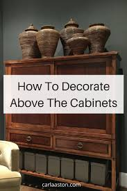 how to decorate space above kitchen cabinets how to decorate the top of a cabinet and how not to designed