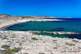 pink sand beach views to mytakas milos greece