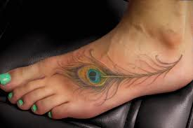 truly awesome feather tattoo on foot photos pictures and