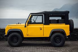 land rover yellow land rover defender d90 beach runner hiconsumption