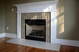 loverly fireplace installation concept with large tunnel and white large mantel as well as closed gas hearth