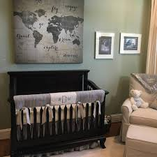 grey crib bedding in a travel theme nursery and we added the