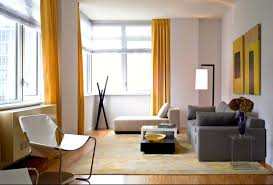 modren living room yellow and gray with frames a rug in design