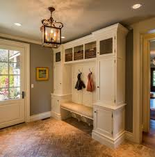 brick floor mudroom entry farmhouse with built in cabinets way switch