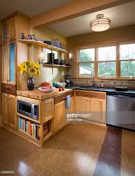 kitchen with butcher block counter and cork floor stock photo