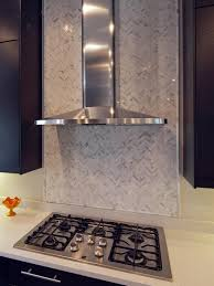 Herringbone Kitchen Backsplash Limestone Tiles Layered In A Herringbone Pattern Create A Focal