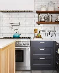 black kitchen cabinets with white subway tile backsplash 48 beautiful kitchen backsplash ideas for every style