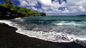 Volcanic Sand Walk On A Black Sand Beach