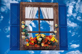 country style window with flowers planter shutters and curtains