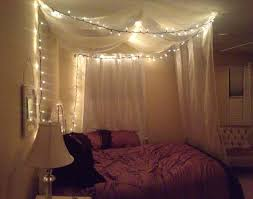 how to make your own sheer mosquito netting canopy canopy diy canopy bed using command strips sheer curtains and wire ornament hooks